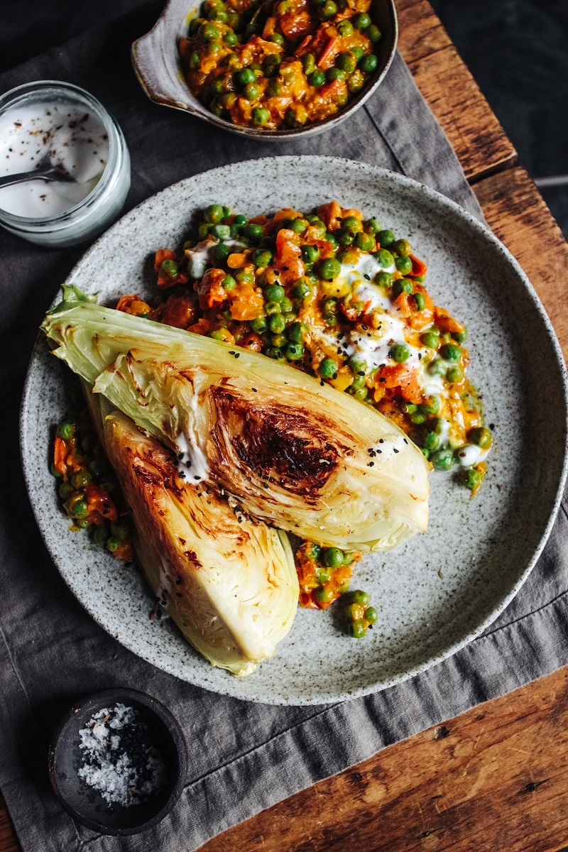 Charred Hispi Cabbage With Tomato, Pea And Coconut Curry